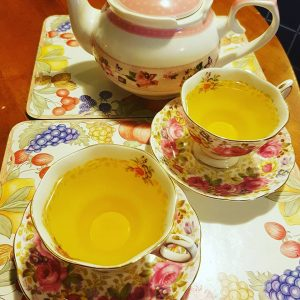 Cups of lemon myrtle tea in beautiful English china cups